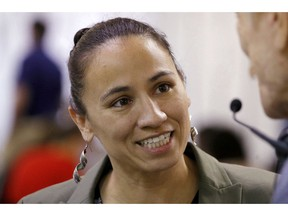 FLE - In this Oct. 1, 2018, file photo, Kansas Democratic Congressional candidate Sharice Davids talks to volunteer at her campaign office in Overland Park, Kan. Davids is challenging Republican incumbent Kevin Yoder in Kansas' 3rd District in the Nov. 6 election.