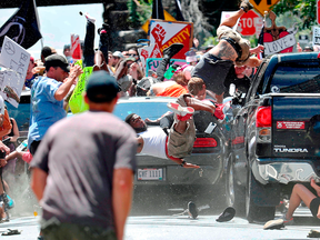 People fly into the air as a car driven by James Alex Fields Jr. goes into a group of protesters demonstrating against a white nationalist rally in Charlottesville, Virginia, Aug. 12, 2017.