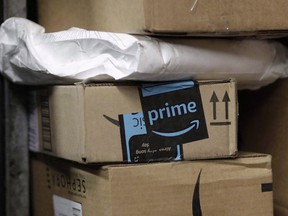 A package from Amazon Prime is loaded for delivery on a UPS truck, in New York on May 9, 2017. Amazon will split its second headquarters between Long Island City in New York and Crystal City in northern Virginia, according to a person familiar with the plans.