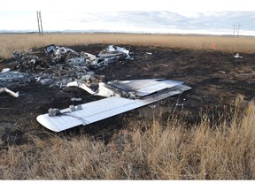 The Transportation Safety Board says a fatal small plane crash west of Calgary last year was likely due to a flight instructor and student losing control during an engine failure simulation done at too low an altitude. Wreckage of a small plane is seen in a field west of Calgary in an October 27, 2017, handout photo.