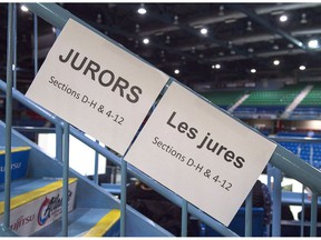 Signs direct potential jurors at jury selection for the retrial of Dennis Oland in the bludgeoning death of his millionaire father, Richard Oland, at Harbour Station arena in Saint John, N.B., Oct. 15, 2018.
