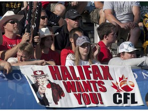Halifax fans show their support for an East Coast franchise as the Calgary Stampeders and Hamilton Tiger-Cats compete in CFL action in Moncton, N.B. on Sunday, Sept. 25, 2011. A group of professional sports executives quarterbacking a plan to bring a CFLteam to Halifax is set to make an announcement Wednesday as it ramps up efforts to secure a conditional expansion franchise
