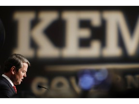 Georgia Republican gubernatorial candidate Brian Kemp speaks with supporters after a long election night in Athens, Ga., Wednesday, Nov. 7, 2018. Georgia's hotly contested and potentially historic governor's race may not be over yet, with Democrat Stacey Abrams and Kemp awaiting the final accounting of absentee and provisional ballots.