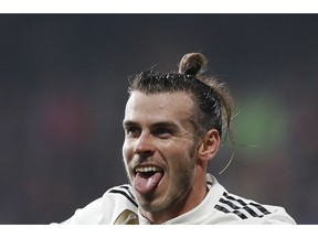 Real midfielder Gareth Bale celebrates after scoring his side's fourth goal during the Champions League group G soccer match between Real Madrid and Viktoria Plzen at the Doosan arena in Pilsen, Czech Republic, Wednesday, Nov. 7, 2018.