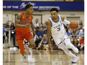 Duke guard Tre Jones (3) tries to dribble around Auburn guard Bryce Brown (2) during the first half of an NCAA college basketball game at the Maui Invitational, Tuesday, Nov. 20, 2018, in Lahaina, Hawaii.