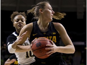 Iowa's Amanda Ollinger, right, is pressured from Notre Dame's Katlyn Gilbert (10) during the first half of an NCAA college basketball game Thursday, Nov. 29, 2018, in South Bend, Ind.