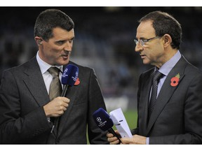 FILE - In this Tuesday, Nov. 5, 2013 file photo, newly appointed Ireland national soccer team coach Martin O'Neill, right, and Roy Keane, who will be his assistant, speak before Manchester United and Real Sociedad face each other in a Champions League Group A soccer match at Anoeta stadium in San Sebastian, northern Spain. Martin O'Neill has ended his five-year stint as Ireland coach and has taken assistant Roy Keane with him.