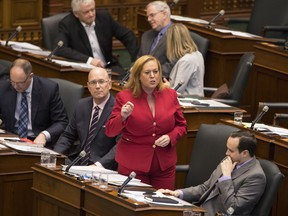 Lisa MacLeod, Ontario's Minister of Children, Community and Social Services stands in the Legislature during question period ahead of making an announcement on the Government's social assistance reform, in Toronto, on Nov. 22, 2018.