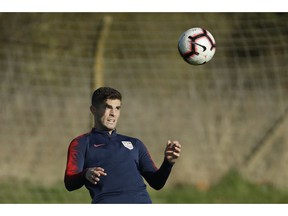 United States national soccer team player Christian Pulisic takes part in their national soccer squad training session at the training facilities of Brentford Football Club in west London, Monday, Nov. 12, 2018. The United States play England in an international friendly soccer match at Wembley stadium in London on Thursday.