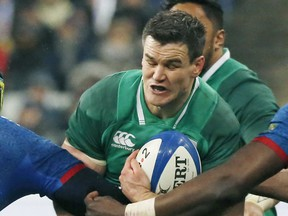 """FILE - In this file photo dated Saturday, Feb. 3, 2018, Ireland's Jonathan Sexton, is caught by France players during their Six Nations rugby union match at the Stade de France stadium in Saint-Denis, outside Paris, France.  Sexton on Monday Nov. 12, 2018, said he supports Conor Murray's """"smart"""" call not to make Ireland's showdown with the All Blacks upcoming weekend his first match in five months after suffering a neck injury."""