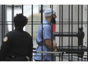 """FILE - In this Feb. 3, 2016 file photo, Adnan Syed enters Courthouse East prior to a hearing in Baltimore. Maryland's highest court is set to hear arguments in the high-profile case of Syed whose murder conviction was chronicled in the hit """"Serial"""" podcast. Two years after a new trial was ordered for Syed, the Maryland Court of Special Appeals on Thursday, Nov. 29, 2018, will hear oral arguments in the case. He was convicted in 2000 of strangling his ex-girlfriend and burying her body in a Baltimore park. Syed is serving a life sentence."""