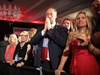 People watch returns being broadcast at an election night event for Florida Governor Rick Scott on Nov. 6, 2018 in Naples, Florida.