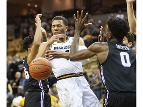 Missouri's Javon Pickett, left, has the ball knocked away by Central Arkansas' SK Shittu, right, during the first half of an NCAA college basketball game Tuesday, Nov. 6, 2018, in Columbia, Mo.