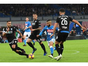 Napoli's forward Lorenzo Insigne, second from right, scores his side's first goal during the Italian Serie A soccer match between Napoli and Empoli at the San Paolo stadium in Naples, Italy, Friday, Nov. 2,  2018.