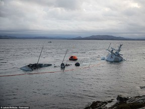 Pictures released by the Forsvaret, Norway's armed forces, on Tuesday morning showed the KNM Helge Ingstad almost totally submerged having run aground last week. The frigate collided with a UK-bound oil tanker and rolled onto its side on Friday despite the crew's insistence the situation was 'under control'.