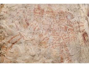 """This composite image from the book """"Borneo, Memory of the Caves"""" shows the world's oldest figurative artwork dated to a minimum of 40,000 years, in a limestone cave in the Indonesian part of the island of Borneo."""