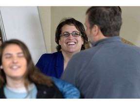 Dana Balter, candidate for the House of Representatives in New York's 24th Congressional District, speaks with family and friends after casting her vote in Syracuse, N.Y., Tuesday, Nov. 6, 2018.
