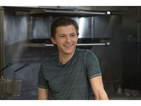 """FILE - In this Nov. 12, 2018 file photo, Tom Holland participates in the Cooking with """"The Avengers"""" event at the Simone Restaurant in Los Angeles. Holland received a cooking lesson with """"Avengers"""" co-director Joe Russo and chef Jessica Largey who introduced him to kabocha squash, a delicacy known as Japanese pumpkin."""