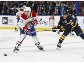 Buffalo Sabres forward Jack Eichel (9) stick-checks Montreal Canadiens forward Brendan Gallagher (11) during the second period of an hockey game, Friday, Nov. 23, 2018, in Buffalo N.Y.