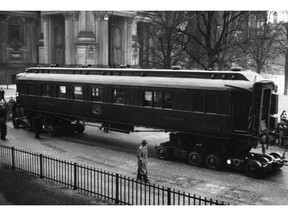 FILE - This March 24, 1941 file photo shows the saloon car of Compiegne, in where the armistice ending World War I was signed on Nov. 11, 1918. The French and German leaders this weekend will jointly visit the remains of the train carriage where the armistice ending World War I was signed on Nov. 11, 1918.  For the French, the dining car became a shrine to peace. For Adolf Hitler, it was a symbol of the humiliation of surrender. The Nazi leader had it dragged to Germany after conquering France in World War II. (AP Photo)