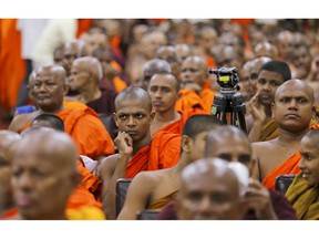 Sri Lankan Buddhist monks supporting ousted prime minister Ranil Wickremesinghe take part in convention held to appeal president Maithripala Sirisena to convene the parliament and restore democracy in Colombo, Sri Lanka, Tuesday, Nov.6, 2018.