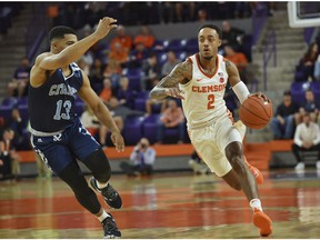 Clemson's Marcquise Reed dribbles to the basket while defended by The Citadel's Lew Stallworth during the first half of an NCAA college basketball game Tuesday, Nov. 6, 2018, in Clemson, S.C.