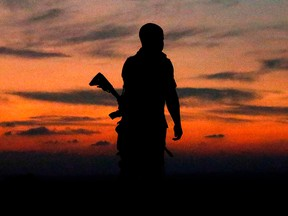 An Israeli soldier is silhouetted against the sky in the southern Israeli town of Sderot on Nov. 13, 2018.