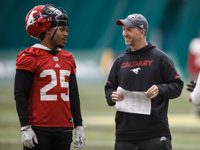 Calgary Stampeders Don Jackson and head coach Dave Dickenson chat during practice in preparation for the Grey Cup in Edmonton, Nov. 21, 2018.