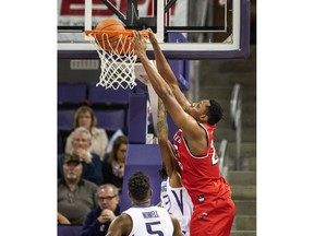 Western Kentucky's Charles Bassey dunks against Washington during the first half of an NCAA college basketball game Tuesday, Nov. 6, 2018, in Seattle.