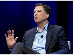 FILE - In this April 30, 2018, file photo, former FBI director James Comey speaks during a stop on his book tour in Washington. Comey has challenged in court a subpoena from the House of Representatives. Lawyers for Comey argued in a court filing on Nov. 29, 2018, that he shouldn't have to appear for a closed-door interview with lawmakers next week.