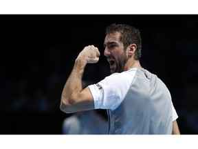 Marin Cilic of Croatia reacts after winning the second set during his ATP World Tour Finals men's singles tennis match against John Isner of the United States at the O2 arena in London, Wednesday, Nov. 14, 2018.