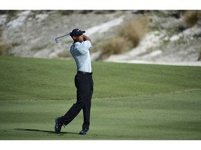 Tiger Woods hits from the fairway at the third hole during the first round of the Hero World Challenge at the Albany Golf Club in Nassau, Bahamas, Thursday, Nov. 29, 2018. Woods now is No. 13 in the world as he hosts this holiday tournament for the 20th time.