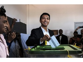 Presidential hopeful Andry Rajoelina, casts his vote at a polling station in Antananarivo, Madagascar, Wednesday, Nov. 7, 2018. Voters go to the polls to elect a president with hopes that a new leader will take the Indian Island nation out of chronic poverty and corruption.