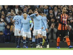 Manchester City players celebrate after scoring the opening goal during the Champions League Group F soccer match between Manchester City and Shakhtar Donetsk at Etihad stadium in Manchester, England, Wednesday, Nov. 7, 2018.
