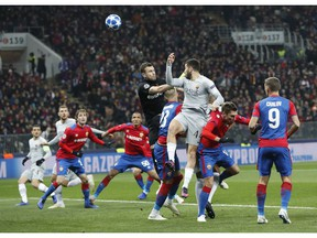 Roma defender Kostas Manolas heads the ball to score the opening goal during a Group G Champions League soccer match between CSKA Moscow and Roma at the Luzhniki Stadium in Moscow, Wednesday, Nov. 7, 2018.