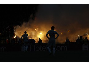 CSKA Moscow supporters light flares during a Group G Champions League soccer match between CSKA Moscow and Roma at the Luzhniki Stadium in Moscow, Wednesday, Nov. 7, 2018.