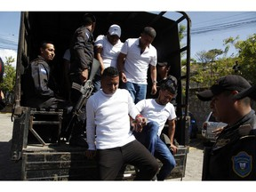 Douglas Bustillo, top left, and Mariano Diaz Chavez, top right, Oscar Aroldo Torres Velazquez, bottom left, and Henry Javier Hernandez Rodriguez, bottom right, accused in the murder of Honduran indigenous and environmental rights activist Berta Caceres, are led in handcuffs to court by police in Tegucigalpa, Honduras, Thursday, Nov. 29, 2018. Seven of the eight accused of Caceres' murder were found guilty by a court and will be sentence on January 2019.