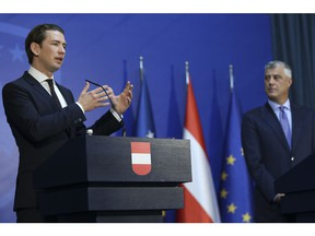 Austrian Chancellor Sebastian Kurz, left, gestures during a joint press conference with Kosovo President Hashim Thaci in Pristina, Kosovo, Tuesday, Nov. 6, 2018. The Austrian Chancellor told Kosovo that dialogue with Serbia is the basis for any further step toward the European Union. Kurz, whose country currently holds the European Union's rotating presidency, said in his visit to Pristina that without a peaceful Pristina-Belgrade agreement there would be no peaceful coexistence and regional stability.