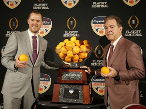 Alabama head coach Nick Saban, right, stands with Oklahoma head coach Lincoln Riley at an NCAA college football news conference in Fort Lauderdale, Fla., Friday, Dec. 28, 2018. Alabama plays Oklahoma in the Orange Bowl on Saturday, Dec. 29.