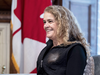Governor General Julie Payette stands next to a shelf featuring memorabilia from her career as an astronaut, in her office at Rideau Hall in Ottawa on Dec. 11, 2018.