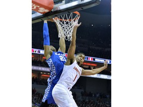 Kentucky forward PJ Washington (25) goes in for a dunk over the defense of Louisville guard Christen Cunningham (1) during the first half of an NCAA college basketball game in Louisville, Ky., Saturday, Dec. 29, 2018.