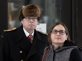 Suspended Vice-Admiral Mark Norman and one of his lawyers, Christine Mainville, outside court in November 2018.