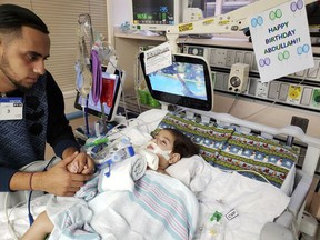 FILE - This recent undated photo, released Monday, Dec. 17, 2018, by the Council on American-Islamic Relations in Sacramento, Calif., shows Ali Hassan with his dying 2-year-old son Abdullah in a Sacramento hospital. Abdullah Hassan, the son of a Yemeni woman who sued the Trump administration to let her into the country to be with the ailing boy has died. The Council on American-Islamic Relations announced Friday, Dec. 28 that Abdullah died in an Oakland, Calif., hospital. He suffered from a genetic brain condition. (Council on American-Islamic Relations via AP, File)