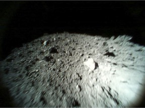 This Oct. 26, 2018, image captured by Rover-1A, and provided by the Japan Aerospace Exploration Agency (JAXA) on Thursday, Dec. 13, 2018, shows the surface of asteroid Ryugu. Japan's space agency JAXA said Thursday, Dec. 13, 2018, more than 200 photos taken by two small rovers on the asteroid show no signs of a smooth area for the planned touchdown of a spacecraft early next year. (JAXA via AP)