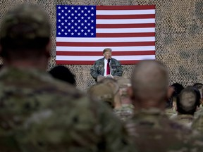 U.S. President Donald Trump speaks to members of the military at a rally at Al Asad Air Base in Iraq on Dec. 26, 2018.
