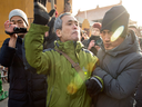 Plainclothes security take away a supporter of Chinese human rights lawyer Wang Quanzhang near the People's Court of Tianjin on Dec. 26, 2018. The trial of Wang, charged with subversion of state power in 2016, is derailed after he fired his state-appointed lawyer.