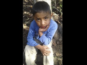 This Dec, 12, 2018 photo provided by Catarina Gomez on Thursday, Dec. 27, 2018, shows her half-brother Felipe Gomez Alonzo, 8, near her home in Yalambojoch, Guatemala. The 8-year-old boy died in U.S. custody at a New Mexico hospital on Christmas Eve after suffering a cough, vomiting and fever, authorities said. The cause is under investigation.