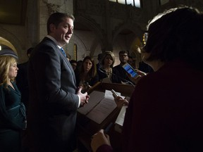 Leader of the Opposition Andrew Scheer speaks with the reporters as Conservative MP Michelle Rempel (left) looks on following Question Period in Ottawa, Tuesday December 4, 2018.