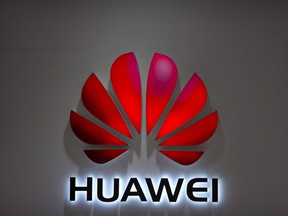 In this July 4, 2018, file photo, the Huawei logo is seen at a Huawei store at a shopping mall in Beijing.