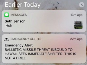 """This smartphone screen capture shows a false incoming ballistic missile emergency alert sent from the Hawaii Emergency Management Agency system on Saturday, Jan. 13, 2018. Almost a year after a false ballistic missile alert terrified Hawaii, Canada is """"finalizing"""" a protocol for notifying the public of a genuine airborne threat of mass destruction."""